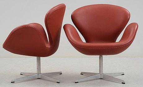 An arne jacobsen red leather 'swan' chair, fritz hansen, denmark 2001.