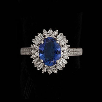 A tanzanite ring, 2.29 cts, set with diamonds, tot. 0.95 cts. 18k white gold. Size 16.5/52.