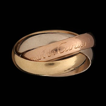 A Cartier, Trinity ring. 18k gold of three shades. (Original box and cert.) Weight ...