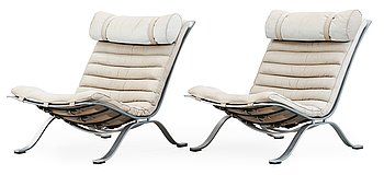 A pair of Arne Norell 'Ari' grey leather lounge chairs, Norell, Sweden.