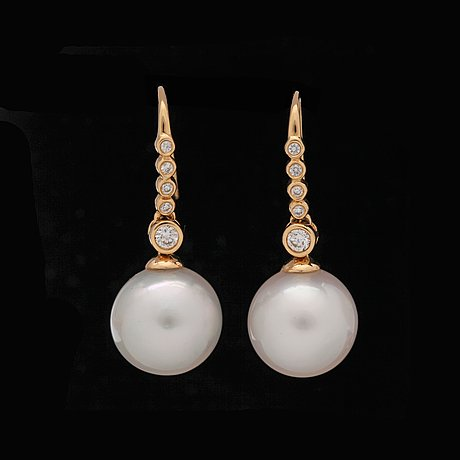 A pair of cultured south sea pearl earrings set with brilliant-cut diamonds, total carat weight circa 0.43 ct.