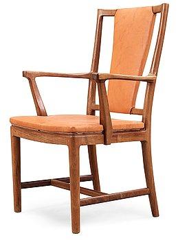 541. A Carl-Axel Acking walnut armchair, upholstered in light brown leather, Nordiska Kompaniet, Sweden, ca 1947.