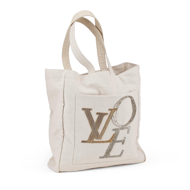 4417694f1b1 LOUIS VUITTON, a beige cotton canvas shoulder bag,