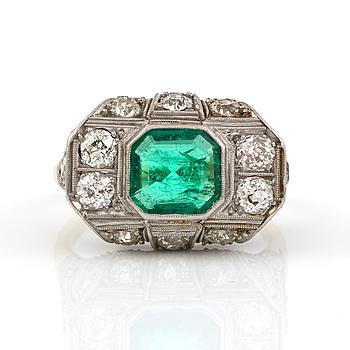 1434. An Art deco, circa 0.70 ct, emerald and 1.00 ct old-cut diamond ring.