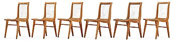 A Louis Sognot set of six ash, metal and rubber chairs, France 1950's.