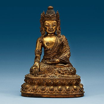 1379. A Tibetan gilt bronze figure of Bodhisattva, presumably 17/18th Century.