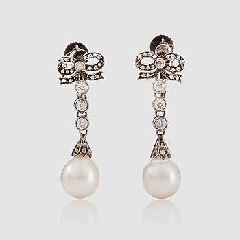 1436. A pair of diamond, circa 0.70 ct, and probably cultured pearl earrings. Stockholm 1910.