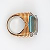 A aquamarine, circa 23.00 cts, and brilliant-cut diamond ring.