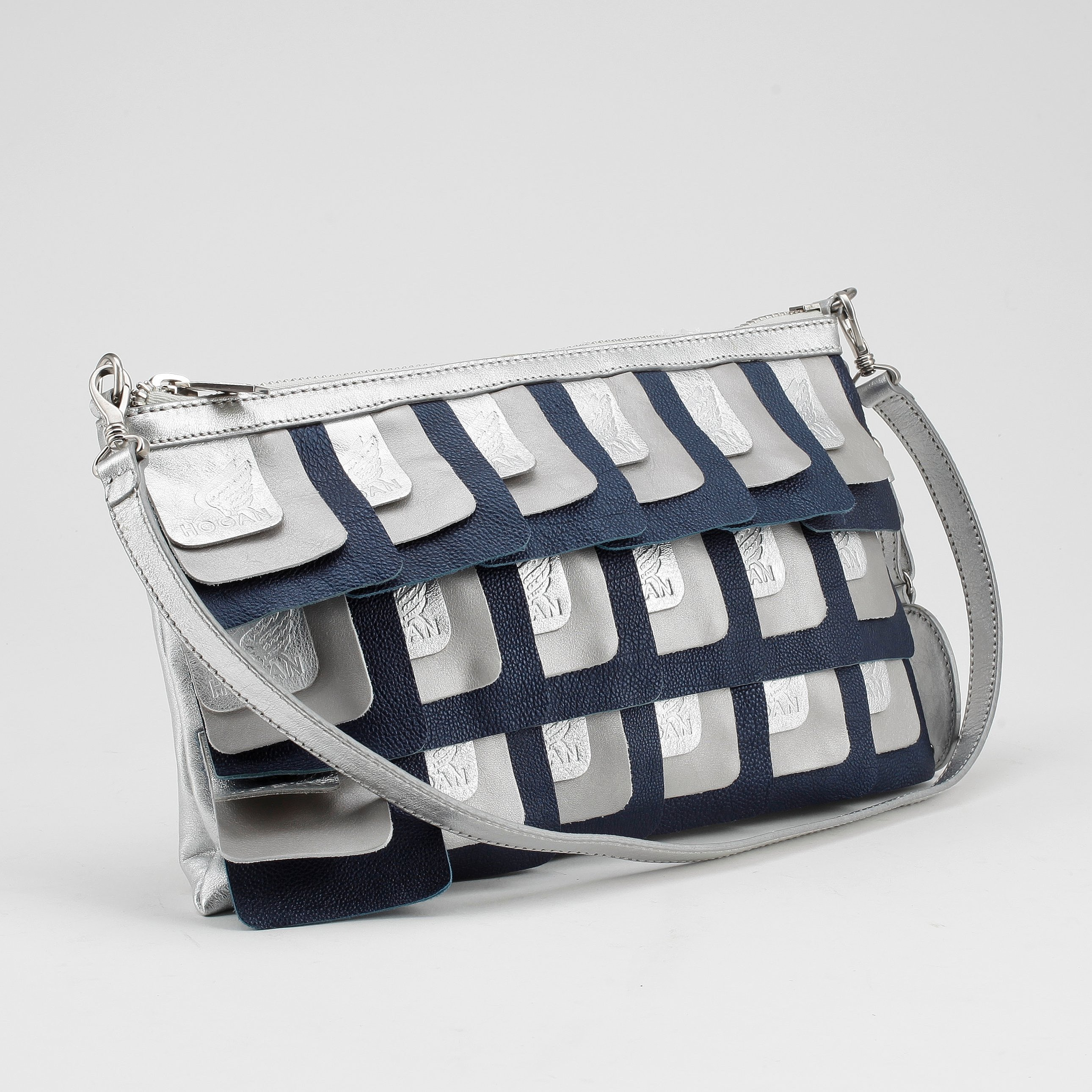 site réputé acd3b 45a8b HOGAN BY KARL LAGERFELD, a silver and blue leather clutch ...