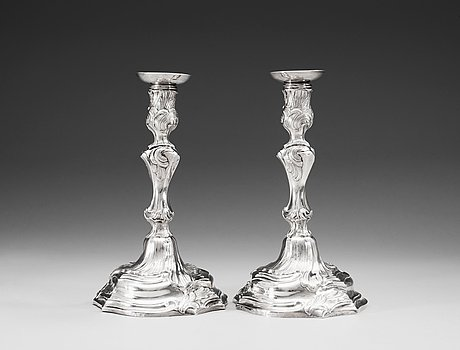 A pair of swedish 18th century silver canlesticks, marks of mikael åström, stockholm 1765.
