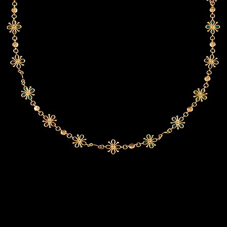 A multicolor enamel necklace in the shape of flowers.