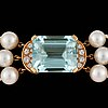 A 3-strand cultured pearl necklace. clasp with a 13.80 cts aquamarine and briliant-cut diamonds.