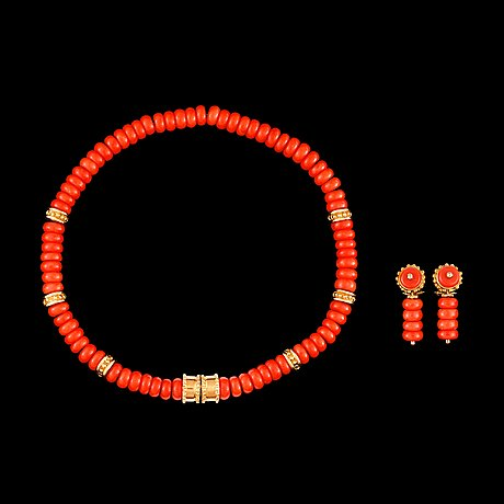 A coral and gold necklace.