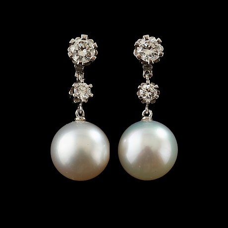 A pair of pearl and diamond earring.