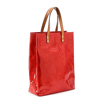 "806. Louis Vuitton, LOUIS VUITTON, a red vernis shopper bag, ""Reade""."