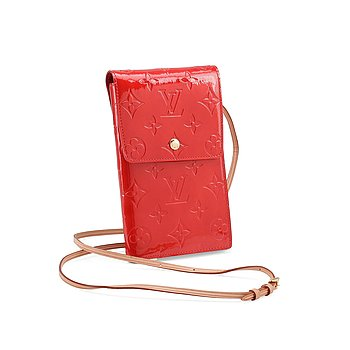 "809. LOUIS VUITTON, a red vernis wallet / travel wallet, ""Walker""."