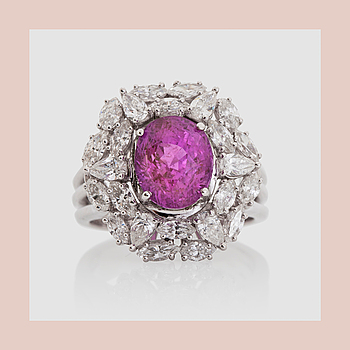 1426. RING, with a pink sapphire, circa 4 cts, marquise and pearshaped diamonds circa 1.54 ct .