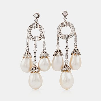 1130. A pair of natural drop-shaped saltwater pearl and diamond Girandole earrings.