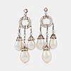 A pair of natural drop-shaped saltwater pearl and diamond girandole earrings.