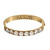 A wiwen nilsson 18k gold bangle with eight cabochon cut moonstones, lund 1947.
