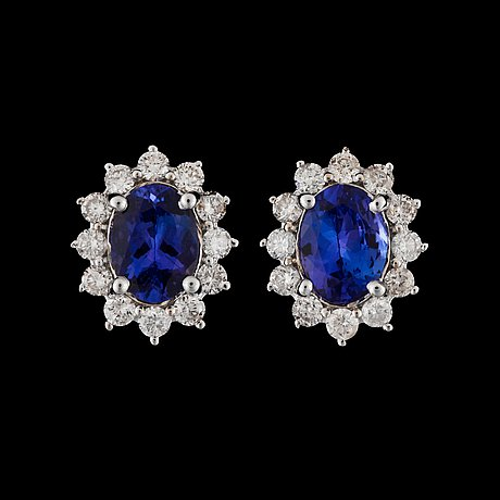 A pair of tanzanite, total circa 2.95 cts, and diamond, total circa 1.00 ct, earring.