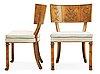 A pair of axel-einar hjorth swedish grace antique patinated 'caesar' chairs, nordiska kompaniet, sweden.