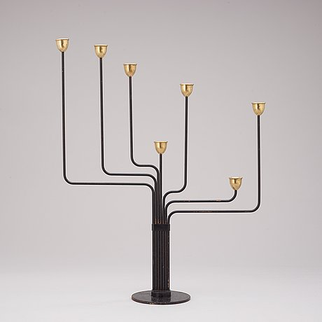 A piet hein brass and black lacquered metal candelabrum, 1950's-60's.
