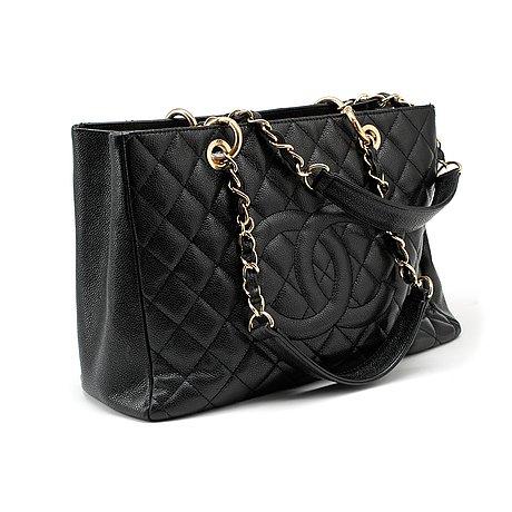 dfaee827ef CHANEL, a black caviar leather purse,
