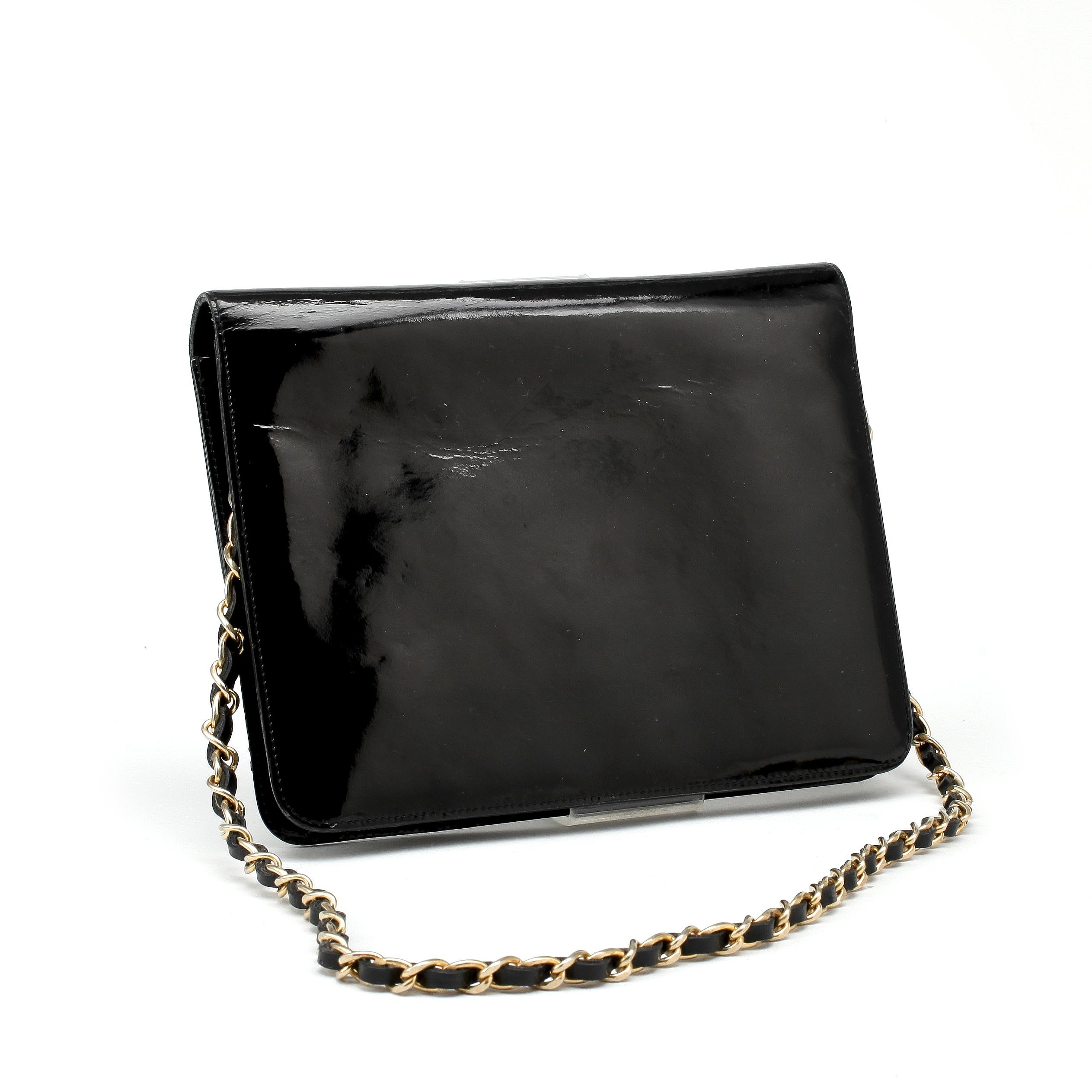 85712f5be688 CHANEL, a black patent leather flap bag. - Bukowskis