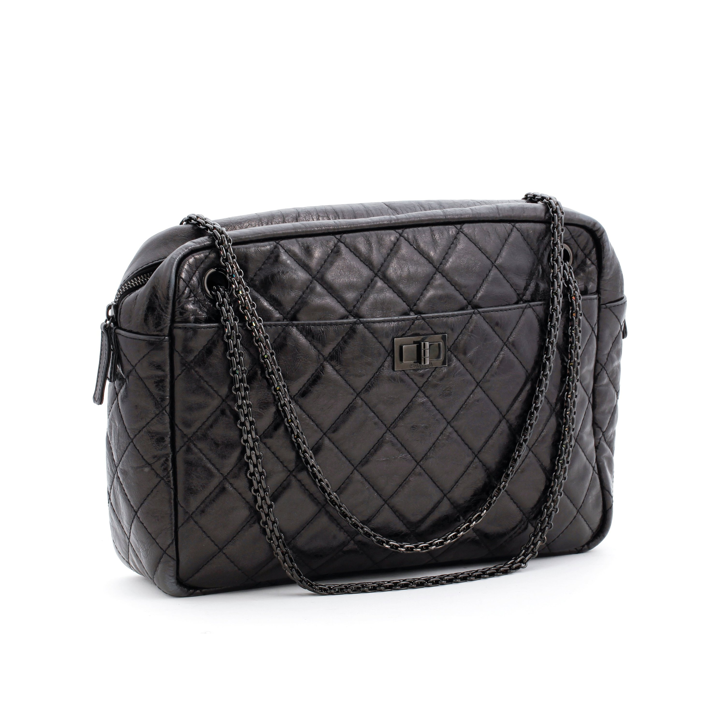 67be245ff140 CHANEL, a quilted black leather shoulder bag,