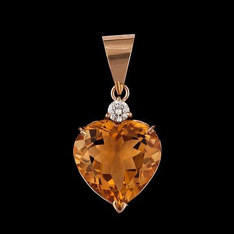 A citrin and diamond, ca 0.10 ct, pendant.