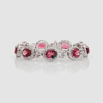 11. A tourmaline, total carat weight 16.20 cts, and diamond, total carat weight 2.99 cts.