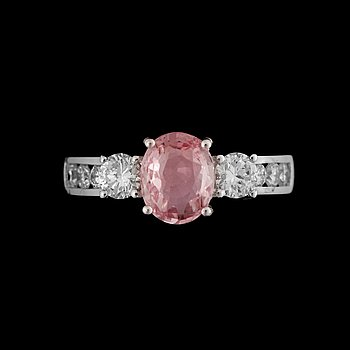 14. A pink sapphire, circa 1.55 cts, and diamond, total circa 0.7 ct, ring.