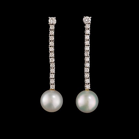 A pair of cultured south sea pearl and brilliant-cut diamond earrings.