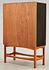 A curt blomberg mahogany cabinet, the doors, sides and top with painted panels, ca 1954.