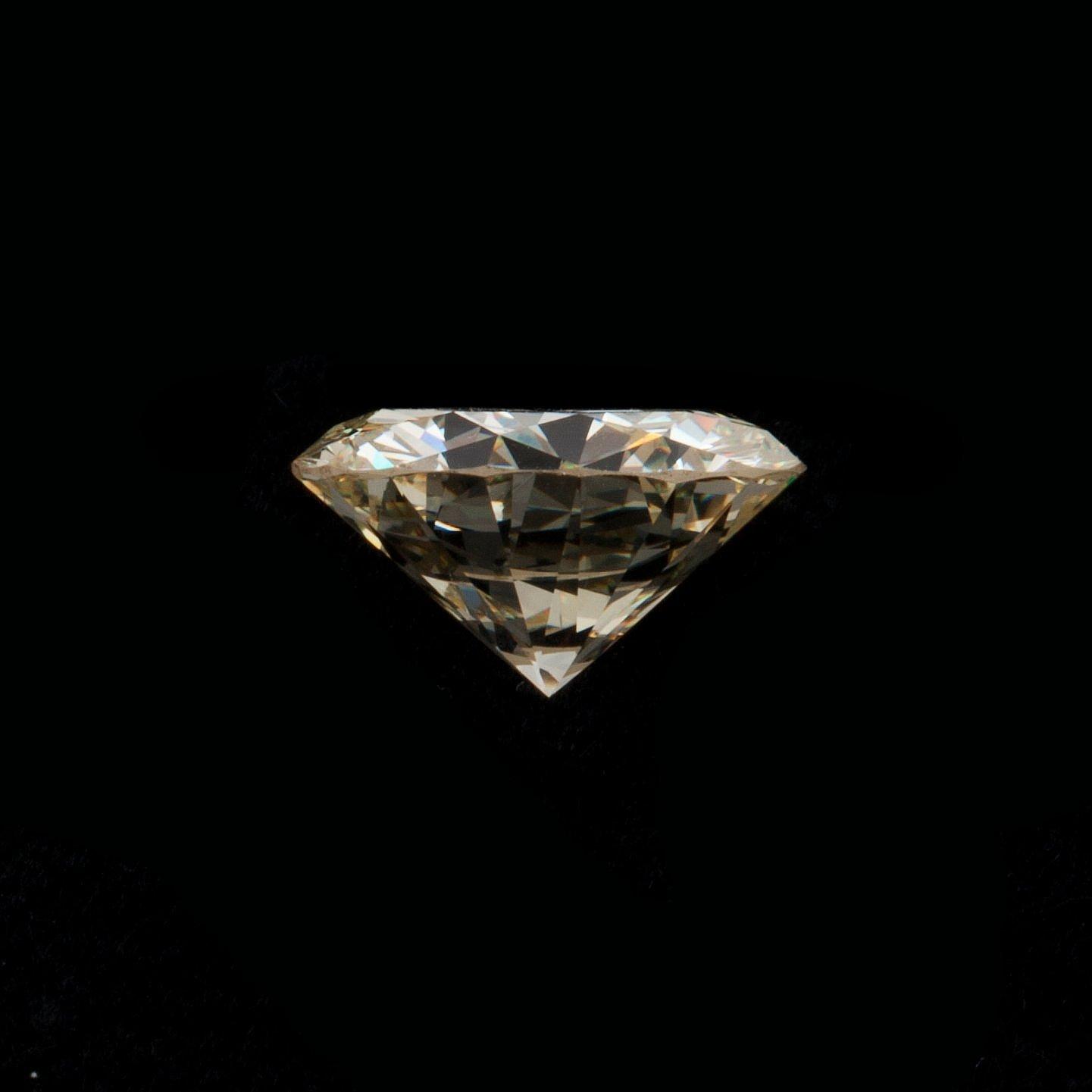 A loose 6 55 ct diamond  Light Yellow/VVS2-VS1  - Bukowskis