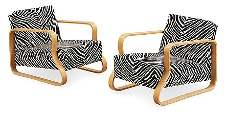 A pair of alvar aalto 'padded paimio' closed-framed armchairs, by o.y huonekalu-ja rakennustyötehdas a.b for artek.