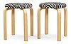 A pair of alvar aalto stools for artek, finland 2002.