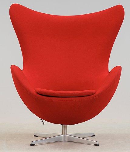 An arne jacobsen red leather 'egg' chair, fritz hansen, denmark 2002.