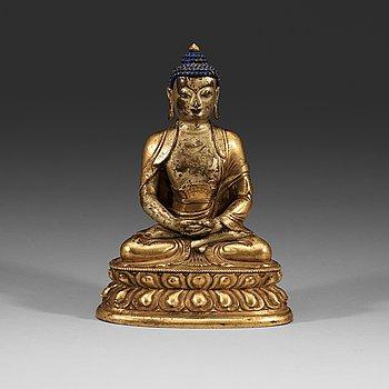 214. A seated Sino-Tibetan part gilt bronze figure of Amithaba Buddha, 18th Century.