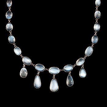 1. A cabochon-cut moonstone necklace. Made by C G Hallberg, Stockholm 1907.