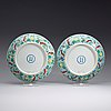 A pair of doucai dishes, republic (1912-49) with yongzhengs six character mark within double circles.