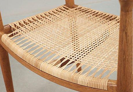 A pair of hans j wegner oak and rattan 'the chair' armchairs by johannes hansen, denmark.
