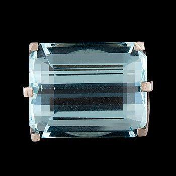 3. A step-cut aquamarine, 25.13 cts, ring.