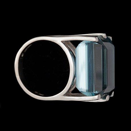 A step-cut aquamarine, 25.13 cts, ring.