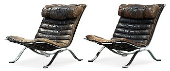 """15. A pair of Arne Norell """"Ari"""" black leather and steel easy chairs by Norell Möbel AB, probably 1960-70's."""