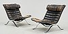 "A pair of arne norell ""ari"" black leather and steel easy chairs by norell möbel ab, probably 1960-70's."