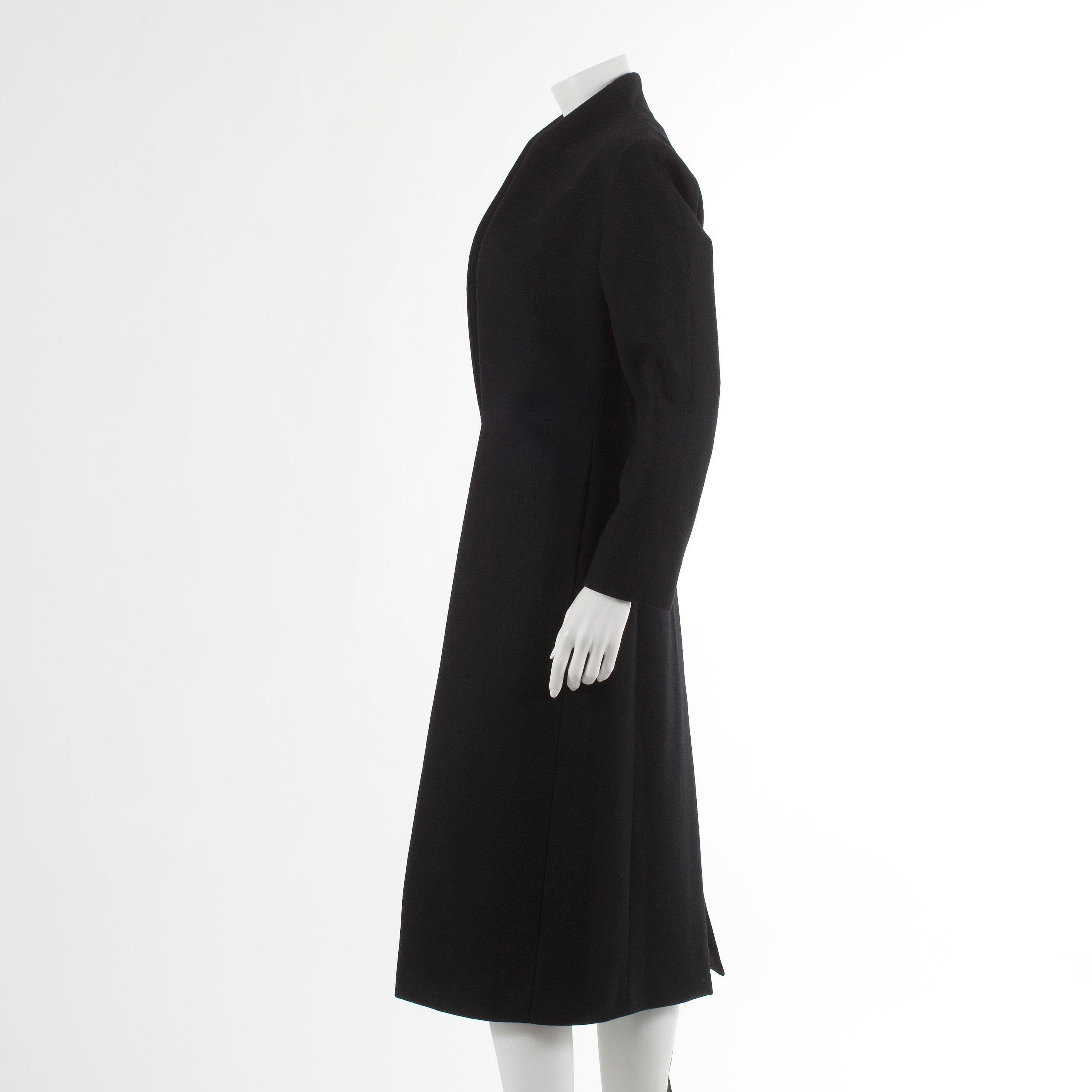 19ccd904e0e YVES SAINT LAURENT, a black wool coat. French size 46. - Bukowskis