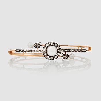 1438. An old- and rose-cut diamond and cultured pearl bracelet.
