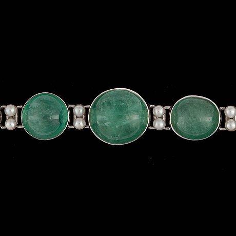 A cultured pearl and cabochon-cut green beryl bracelet.
